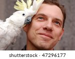Man With Parrot Sitting On The...