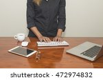 female hands typing on a... | Shutterstock . vector #472974832