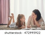 happy loving family. pretty... | Shutterstock . vector #472995922