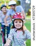 smiling little girl riding a...   Shutterstock . vector #47305729
