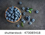 blueberries in the bowl on a... | Shutterstock . vector #473085418
