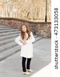 young girl posing in the park.... | Shutterstock . vector #473133058