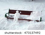 Snowman Sitting On The Bench