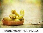pickled green gherkins  | Shutterstock . vector #473147065