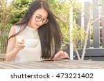 asian woman using tablet... | Shutterstock . vector #473221402