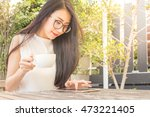 asian woman using tablet... | Shutterstock . vector #473221405