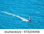windsurfer on a blue sea   Shutterstock . vector #473234458