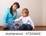 mother helping son put the toy | Shutterstock . vector #47323603