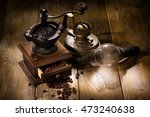 coffee mill and old oil lamp | Shutterstock . vector #473240638