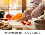 Knife Cuts Small Tomato. Bell...
