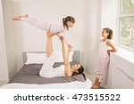 young mother with children gets ... | Shutterstock . vector #473515522