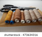 spools brown thread with... | Shutterstock . vector #473634316