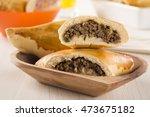 brazilian snack. meat esfiha on ... | Shutterstock . vector #473675182