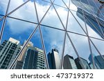 mirrored office buildings | Shutterstock . vector #473719372