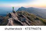 winner man on peak of rocks... | Shutterstock . vector #473796076