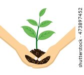 two hands holding young plant... | Shutterstock .eps vector #473897452