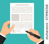 hand holds document and other... | Shutterstock .eps vector #473982568