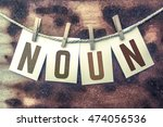 """the word """"noun"""" stamped on... 