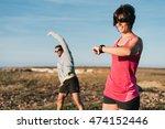 couple runners warming up... | Shutterstock . vector #474152446