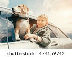 boy and dog look out from car... | Shutterstock . vector #474159742