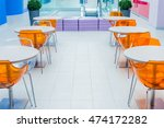 orange plastic chairs and a... | Shutterstock . vector #474172282