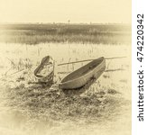 Small photo of Traditional mokoro (national boat) in The Okavango Delta, Botswana, South-Western Africa (stylized retro)