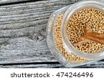 mustard seed in jar with spoon... | Shutterstock . vector #474246496
