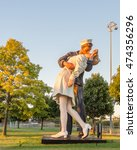 Small photo of ROYAL OAK, MI/USA - AUGUST 22, 2016: Victory in Europe (VE) Day statue, Woodward Ave, Memorial Park; a rendition of Alfred Eisenstaedt's photo of a Navy man kissing a woman at the end of World War II.