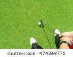 golfer putting golf ball on the ... | Shutterstock . vector #474369772