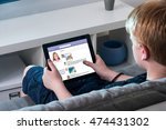 boy sitting on sofa using... | Shutterstock . vector #474431302