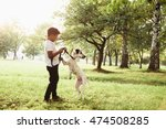 small boy playing with his dog... | Shutterstock . vector #474508285