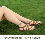 female legs with tattoos on... | Shutterstock . vector #474571525