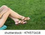 female legs with tattoos on... | Shutterstock . vector #474571618