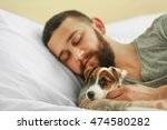 handsome man with cute dog... | Shutterstock . vector #474580282