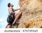 young fearless man climbing a...   Shutterstock . vector #474739165
