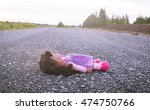Small photo of Concept Abandoned Person,Abandoned doll laying on road,vintage tone