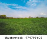 green field and blue sky in... | Shutterstock . vector #474799606