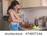 young mom cooking in the... | Shutterstock . vector #474857146