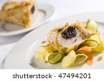 pork with plums - stock photo