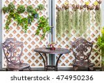 table and chairs in the flowers ... | Shutterstock . vector #474950236