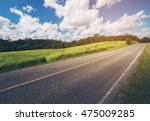 road up hill with green grass... | Shutterstock . vector #475009285