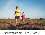 sporty couple running outdoor... | Shutterstock . vector #475026988