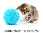 Stock photo small funny kitten and clew of thread isolated on white background 475041892