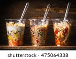 healthy salads in plastic cups... | Shutterstock . vector #475064338