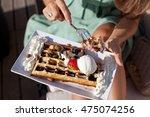 closeup of woman eating belgium ...   Shutterstock . vector #475074256