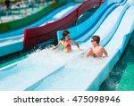 children on water slide in aqua ... | Shutterstock . vector #475098946
