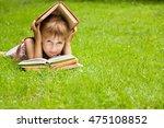 little schoolgirl is reading a... | Shutterstock . vector #475108852
