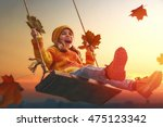 happy child girl on swing in... | Shutterstock . vector #475123342