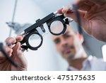 Close Up Of Optometrist Holdin...