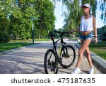 pretty blonde in the park on a... | Shutterstock . vector #475187635